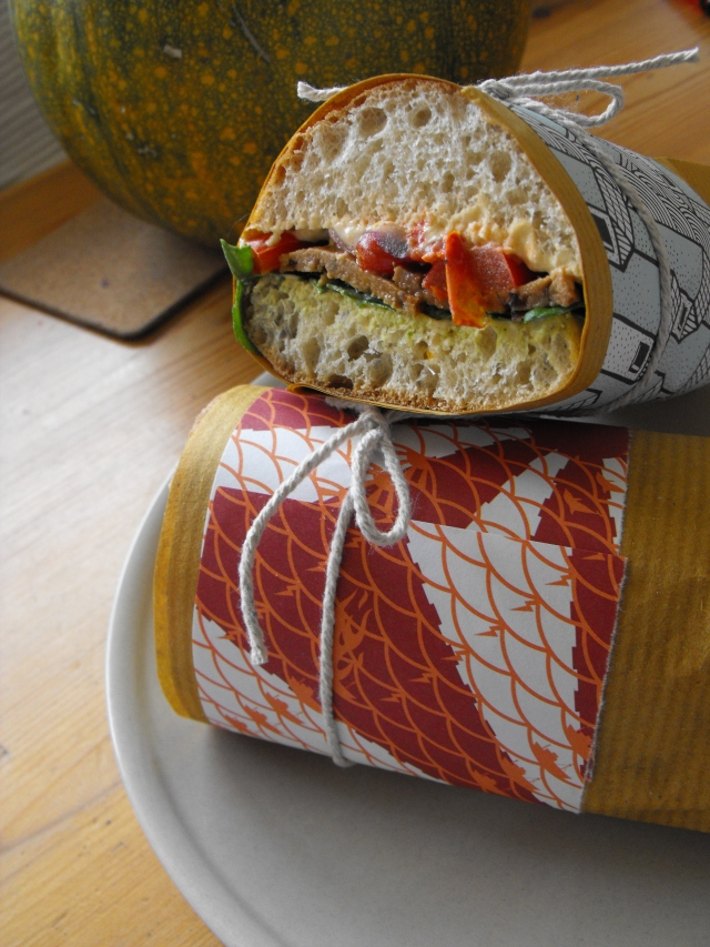 home made sietan-aduki-bean-peperoni sammich, with roasted red peppers, plum toms, red onions, hummus and spinach.